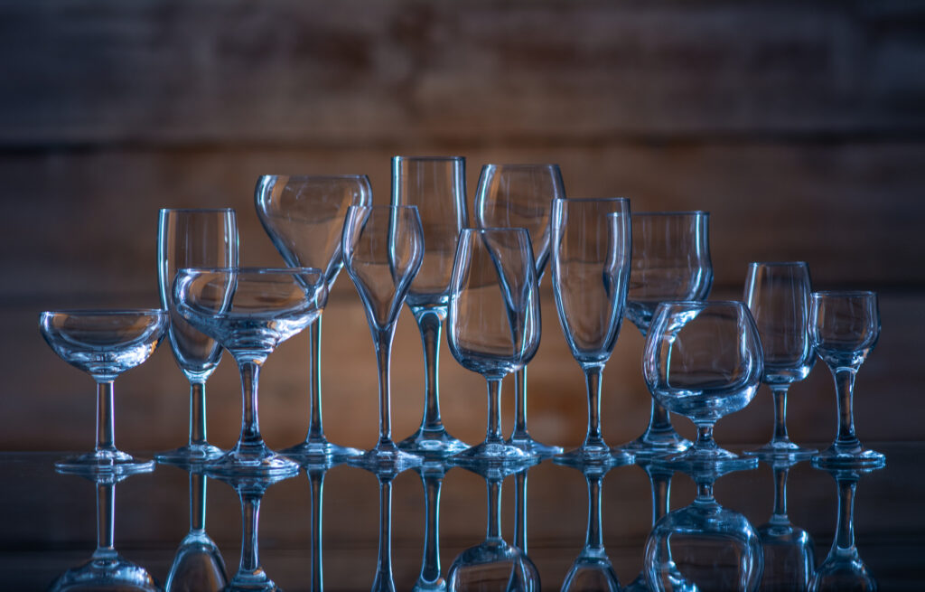 many glasses of different shapes