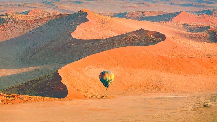 Hot air balloon above the dunes of the Namib Desert at Sossusvlei