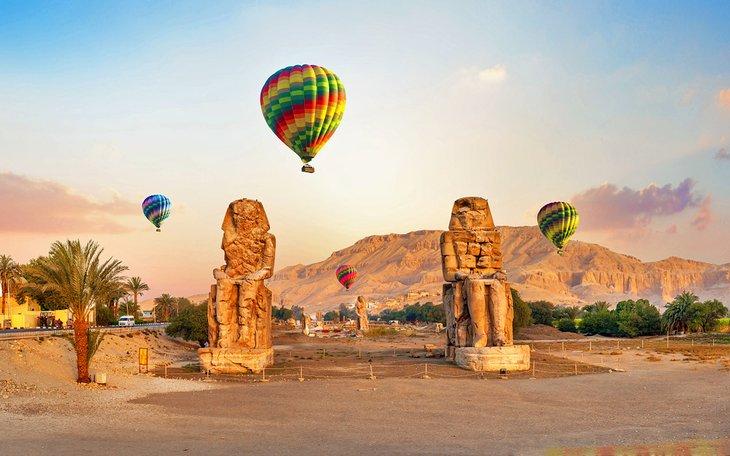 Hot air balloons over the Collosi of Memnon, Luxor
