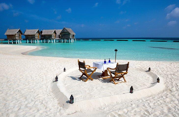 Romantic beach dining in The Maldives