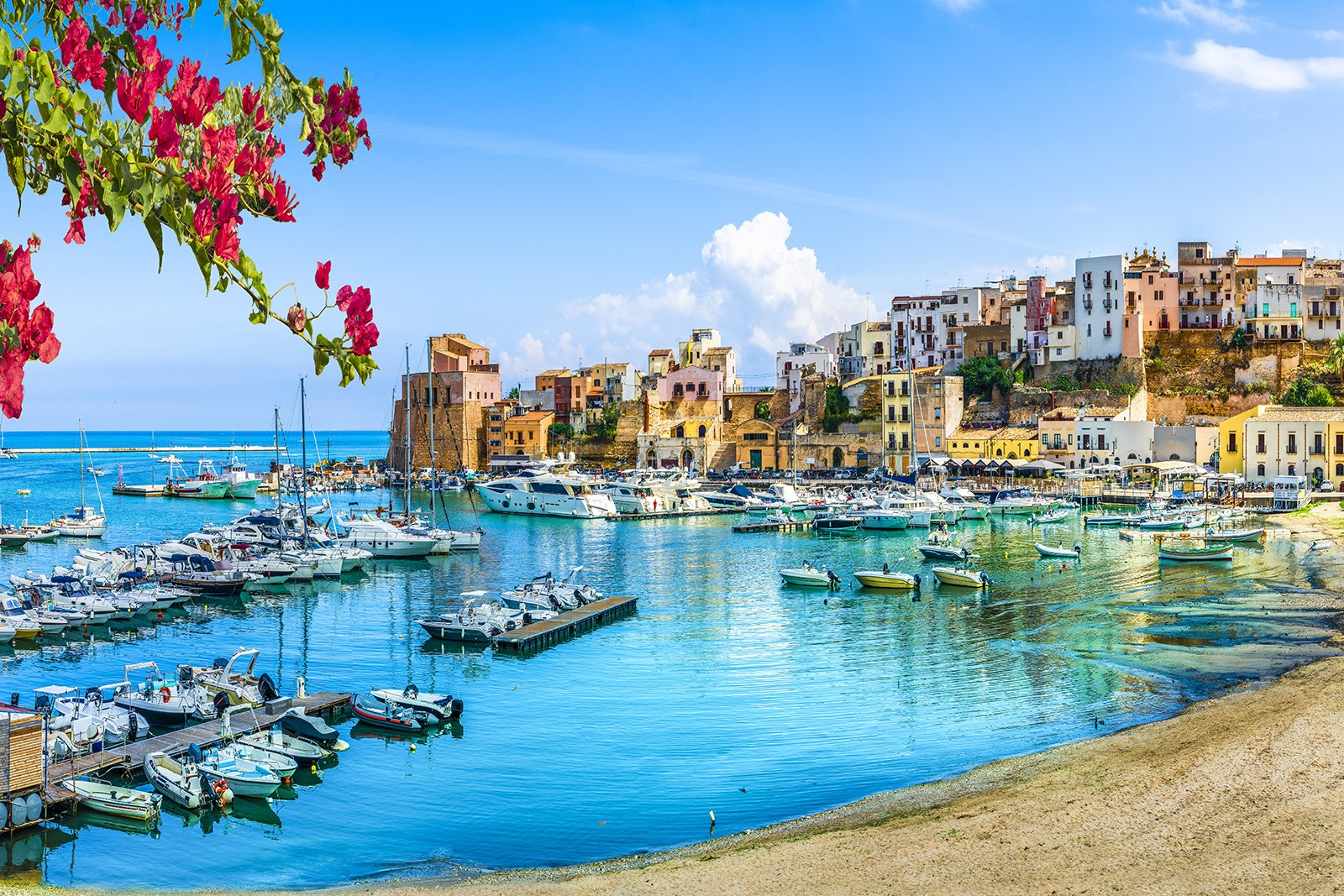 Sicily Italy landscape with water and homes in background