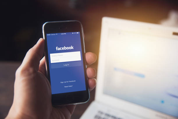 Facebook App on iPhone with computer