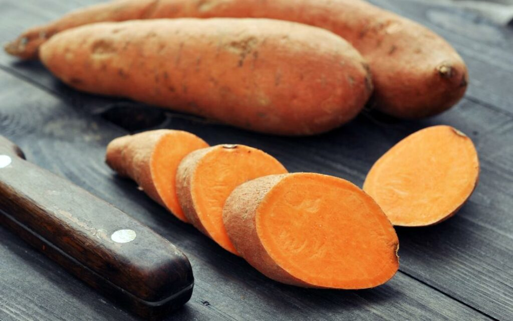 sweet-potatoes-chopped-on-a-wooden-surfac